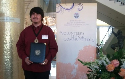 Josue receives the Los Angeles County Volunteer of the Year Award
